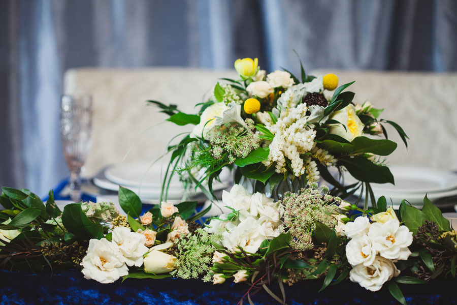 head table wedding floral arrangement, white and yellow flowers, by Vancouver Island florist petal and Kettle, Parksville, B.C.