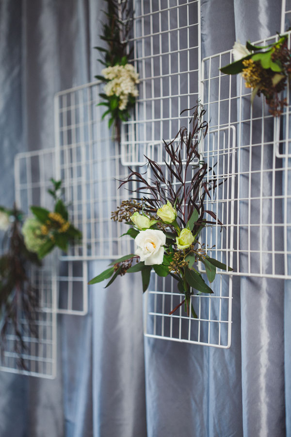 Wall of wedding floral bouquets with white roses, by Oceanside florist Petal and Kettle, Vancouver Island