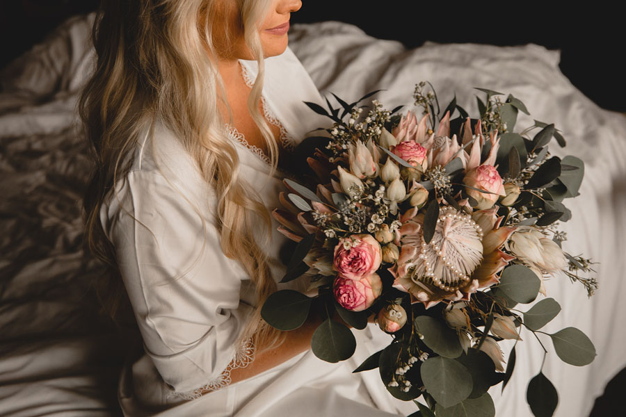 Bride holding wedding bouquet, by Petal and Kettle florist in Parksville, B.C