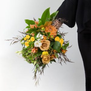 tan, yellow, white, peach flowers in bridal bouqet assembled in Parksville B.C. by florist Petal and Kettle