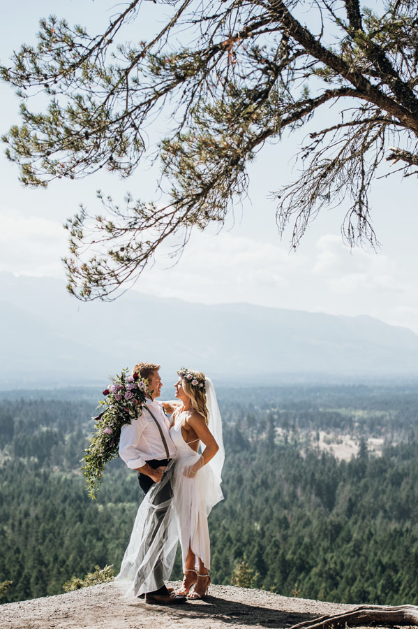 Bride and groom on mountain with purple rose wedding bouquet, assembled by Petal and Kettle florist Parksville Vancouver Island