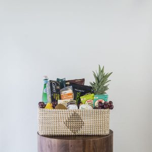 gourmet food gift basket including salami, cheese, spreads, fruit, assembled by Parksville florist