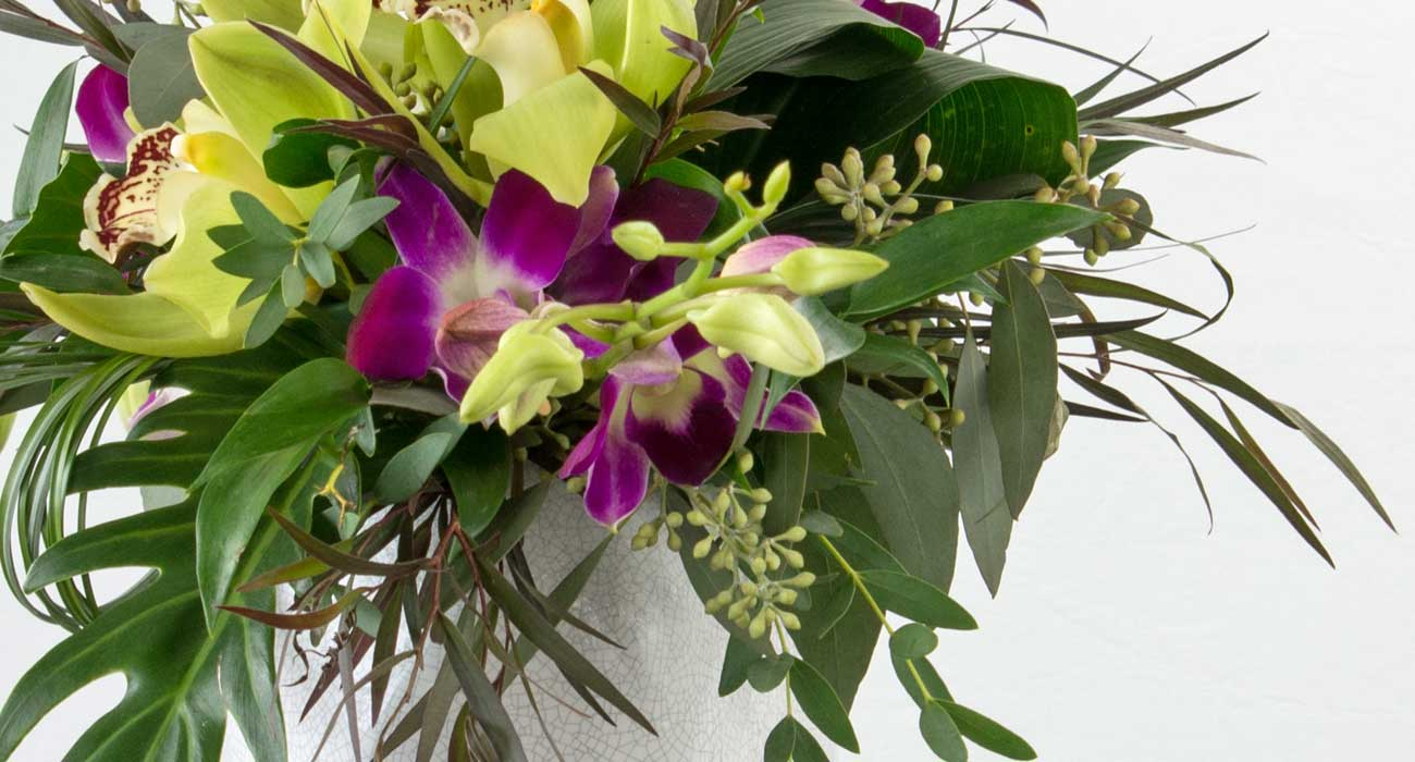 Tropical flower vase arrangement by Parksville florist Petal and Kettle
