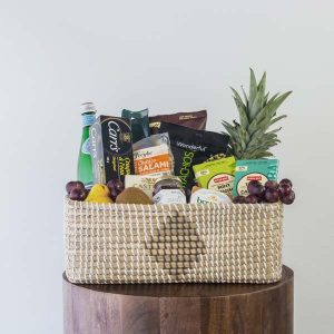 gourmet gift basket filled with food items assembled by Parksville gift basket maker Petal & Kettle