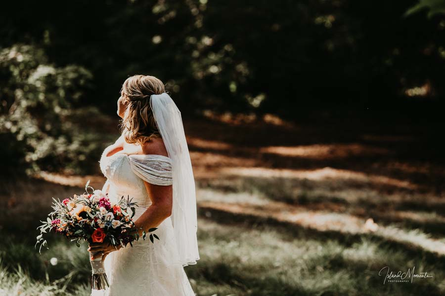 bride holding wedding bouquet on Vancouver Island, bridal flowers by Petal and Kettle