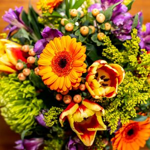 cheerful yellow and purple flower vase arrangement from Qualicum Beach Parksville Nanaimo floral delivery service and florist Petal and Kettle